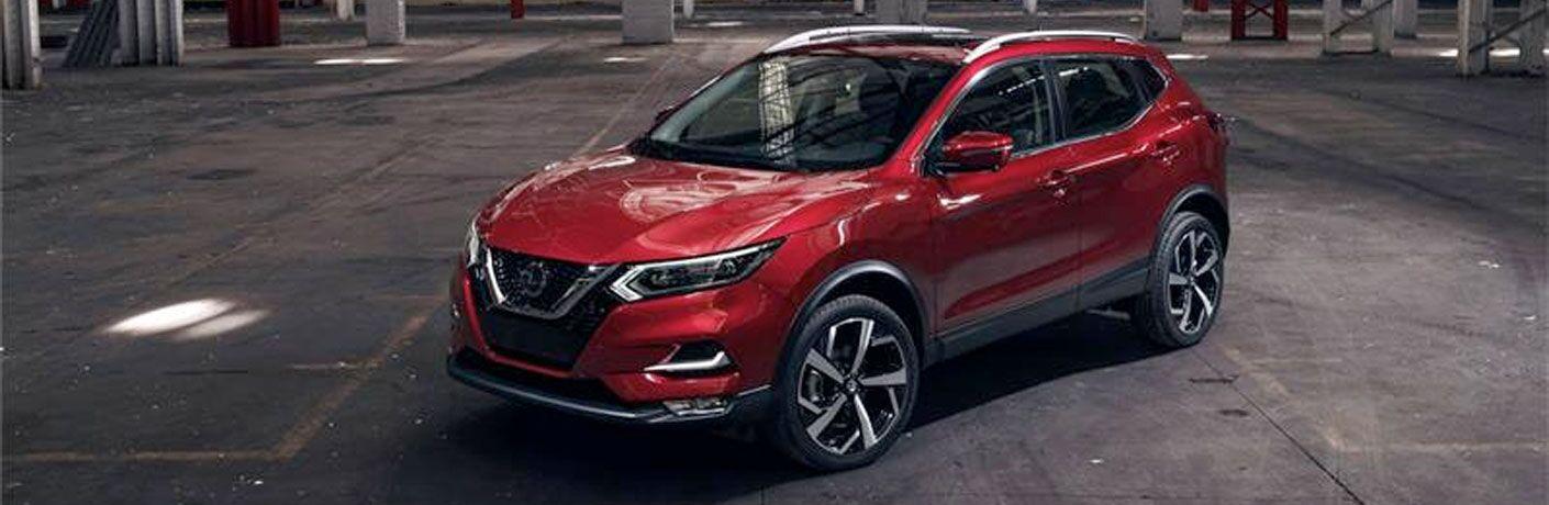 red 2020 Nissan Rogue Sport in parking garage