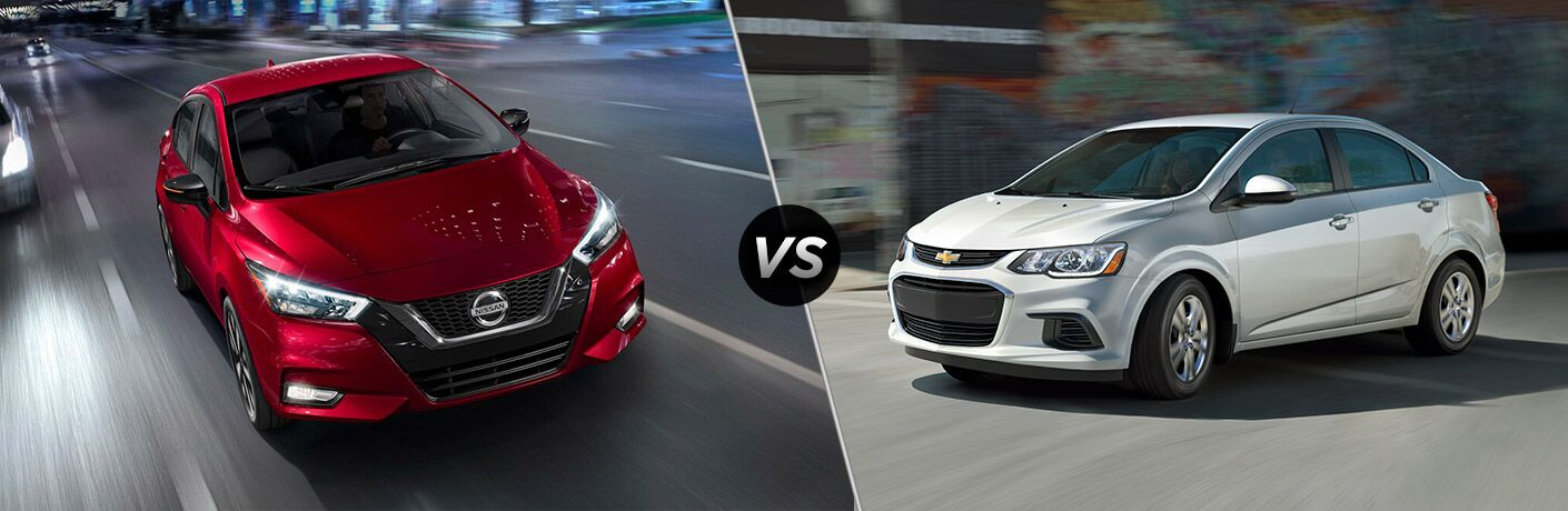 Red 2020 Nissan Versa, VS icon, and silver 2020 Chevrolet Sonic Sedan