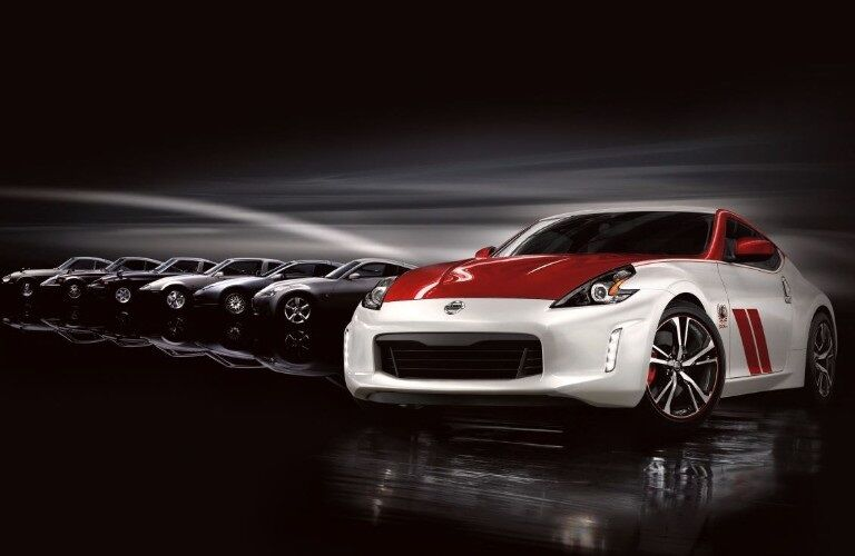 Red and white 2020 Nissan 370Z in front of lineup of 370Z models