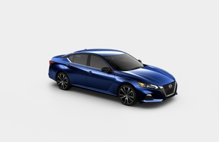Blue 2020 Nissan Altima SR on a gray background