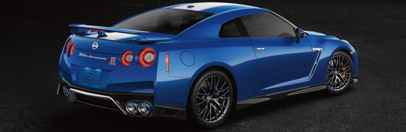 Side view of a blue 2020 Nissan GT-R on a black background