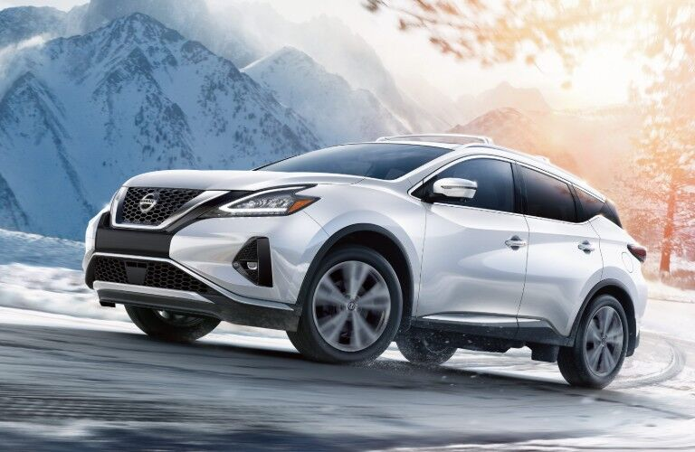 White 2020 Nissan Murano driving on snowy road