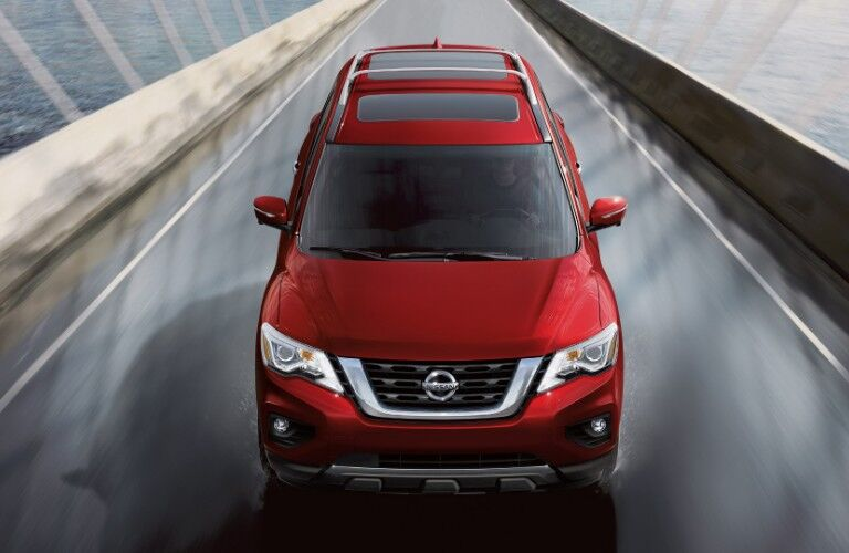 Overhead view of red 2020 Nissan Pathfinder driving on bridge