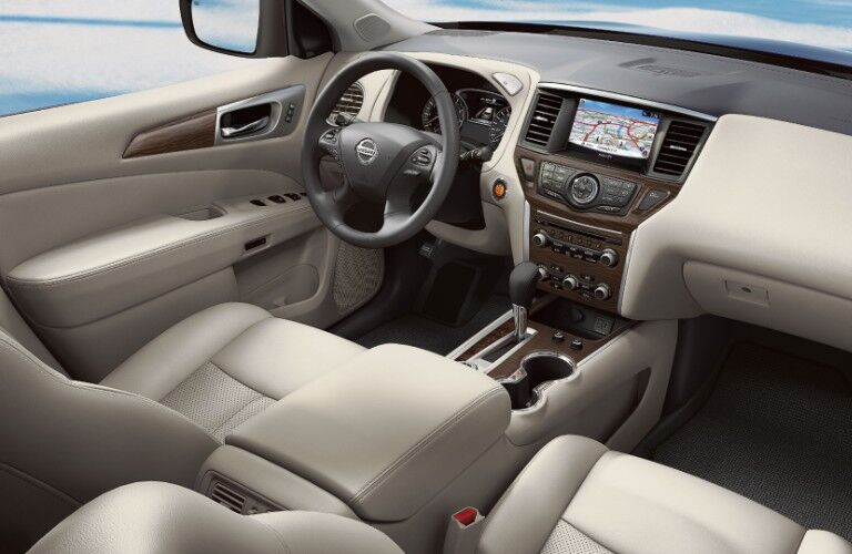 2020 Nissan Pathfinder cabin with steering wheel and dashboard in frame