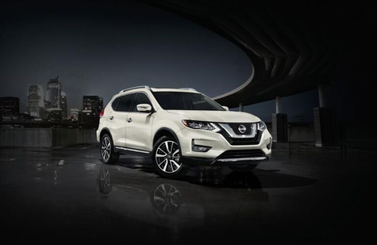 White 2020 Nissan Rogue on a black background
