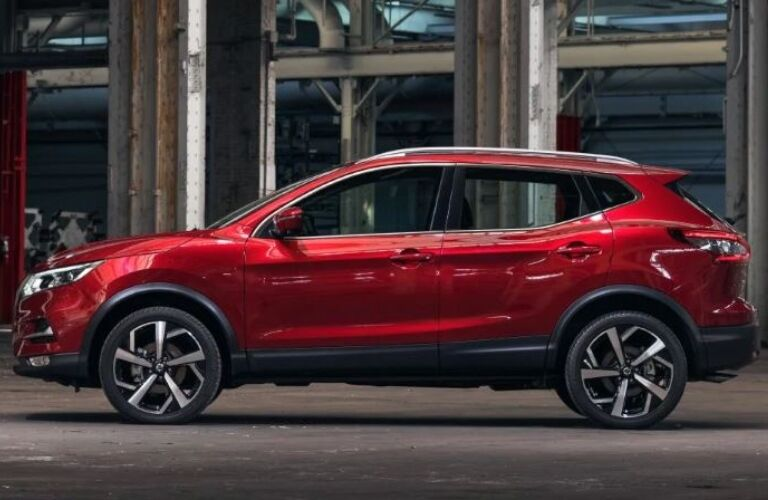 Side view of a red 2020 Nissan Rogue Sport