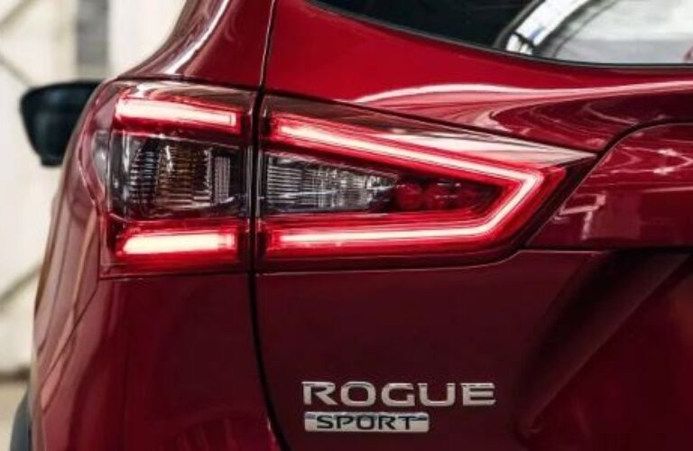 Rogue Sport badge on the back of a red 2020 Nissan Rogue Sport