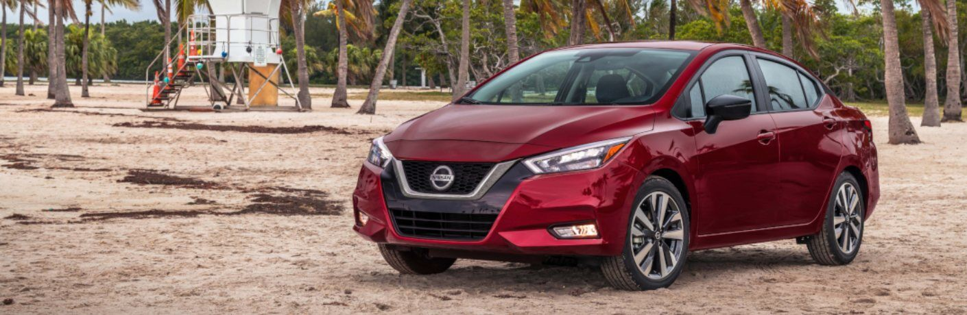 Red 2020 Nissan Versa parked on the beach