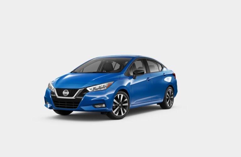 Blue 2020 Nissan Versa SR on a gray background