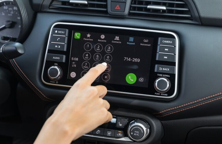 Woman using infotainment system in the 2020 Nissan Versa