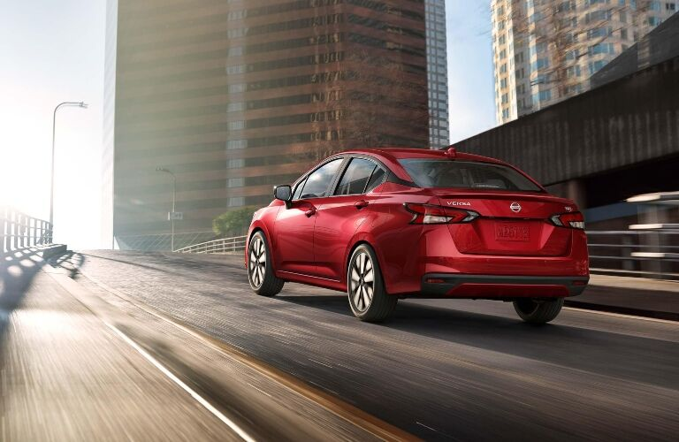 Red 2020 Nissan Versa on highway on-ramp