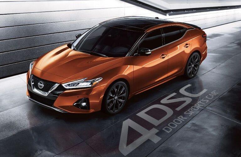 Orange 2020 Nissan Maxima in tunnel