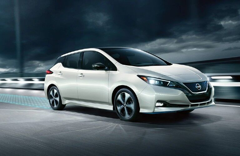 white 2020 Nissan Leaf driving over bridge