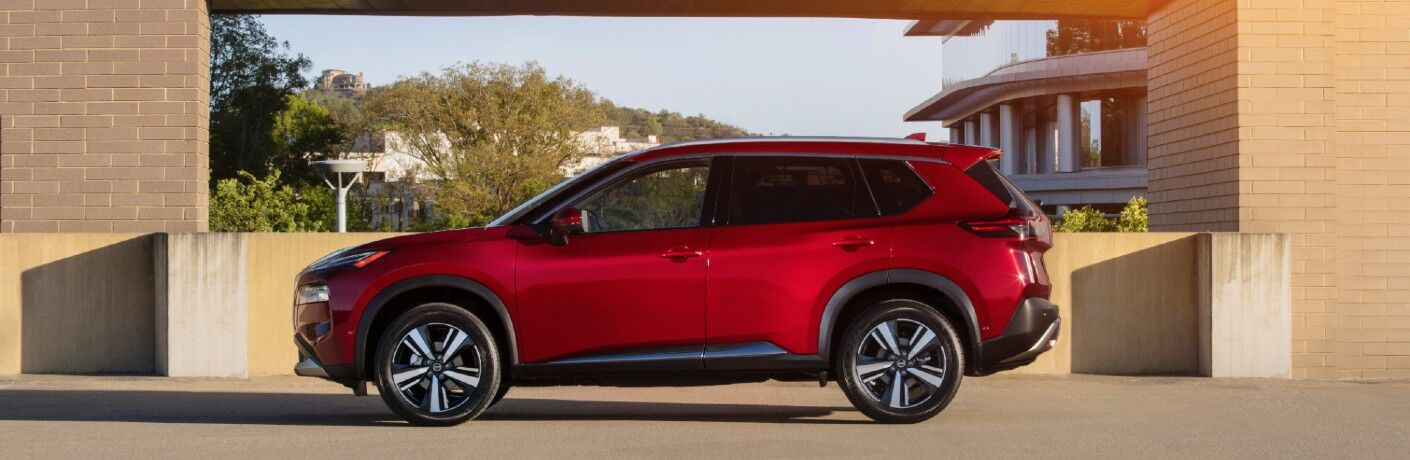 side view of red 2021 Nissan Rogue