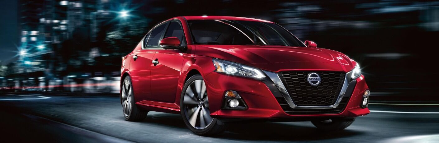 2020 Nissan Altima driving through city at night
