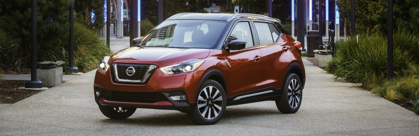 Red 2018 Nissan Kicks parked on a walkway