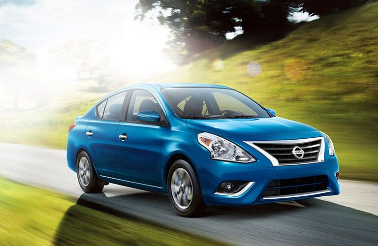 Side view of a blue 2018 Nissan Versa