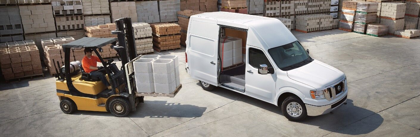 2021 Nissan NV Cargo van being loaded up by a fork lift