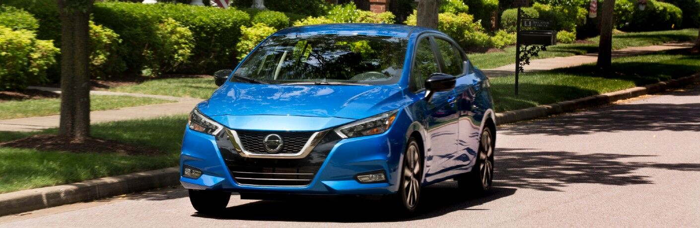 2021 Nissan Versa driving through neighborhood