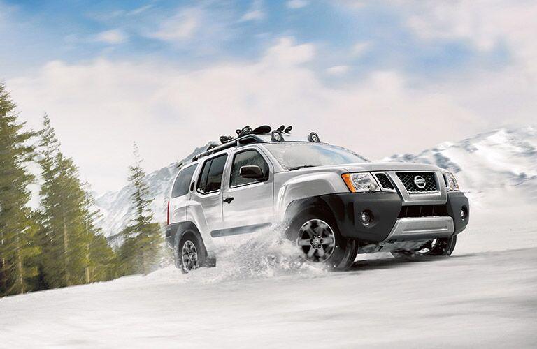 Nissan Xterra driving through the snow