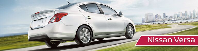 2018 Nissan Versa driving toward city banner