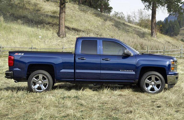 Blue 2016 Chevy Silverado in farm country