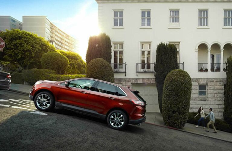 2016 Ford Edge in red on an inclined city street
