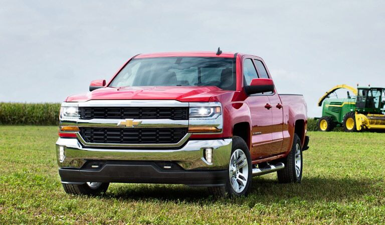 Chevy Silverado 1500 light-duty full-size truck in red on a farm