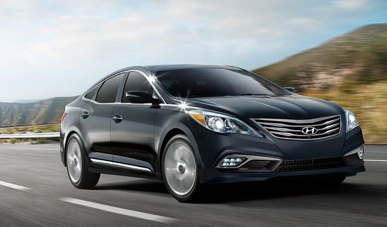 black 2016 Hyundai Azera driving fast on the road