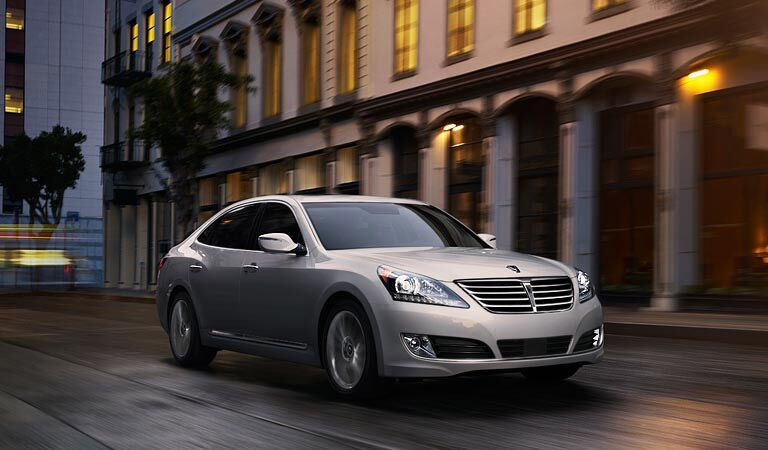 grey 2016 Hyundai Equus driving through the old city at night