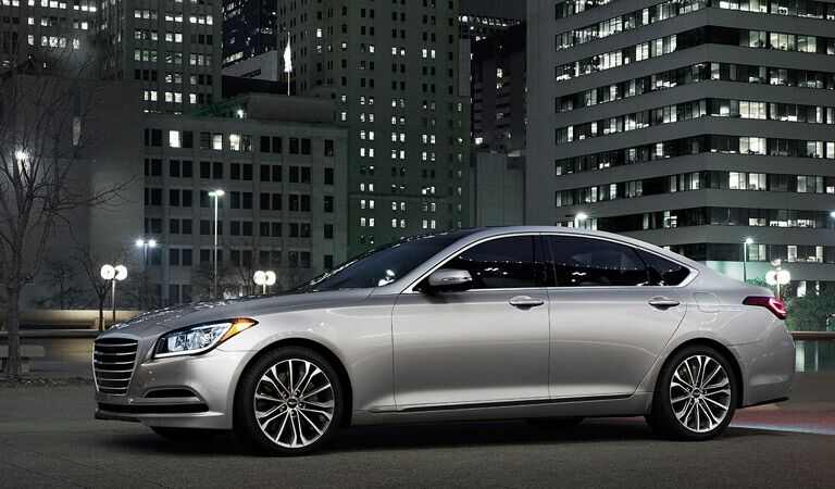profile of the 2016 Hyundai Genesis with a background of skyscrapers