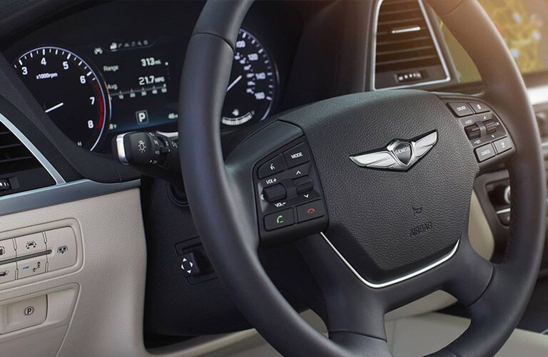 steering wheel and gauge cluster of the 2017 Genesis G80