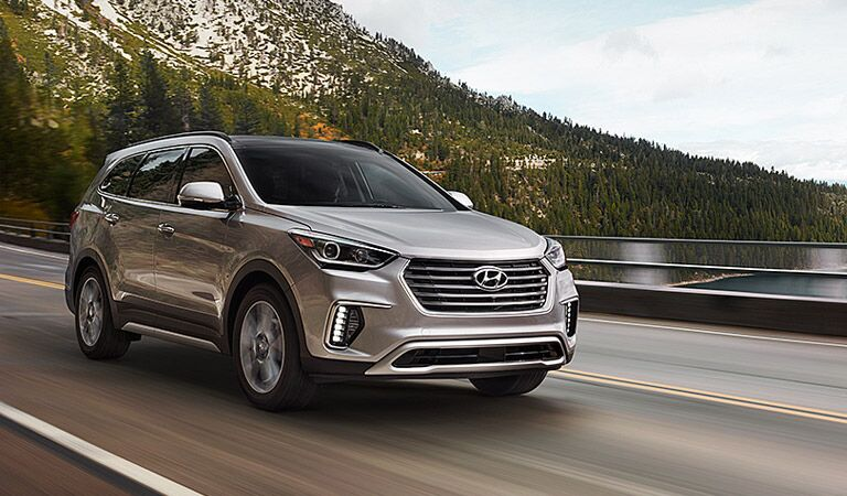 grey or silver 2017 Hyundai Santa Fe driving near a bay