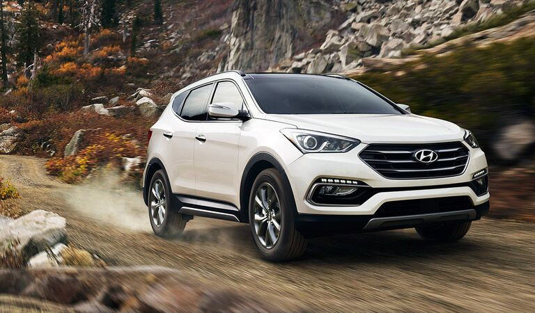 white 2017 Santa Fe Sport tackling rough mountain paths