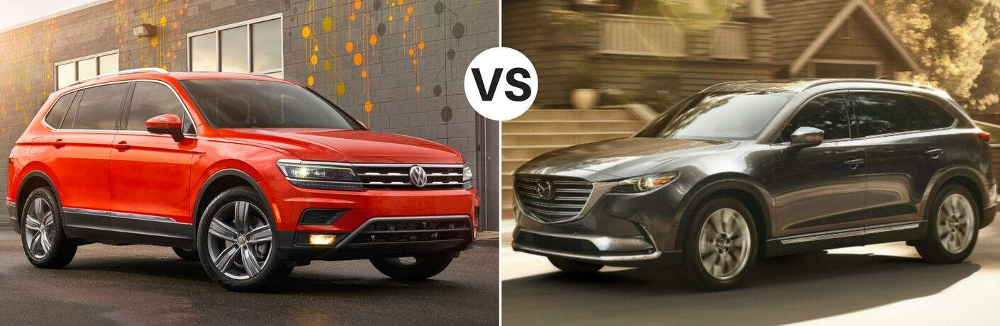 Orange 2018 VW Tiguan Next to Building vs Black 2018 Mazda CX-9 on a City Street
