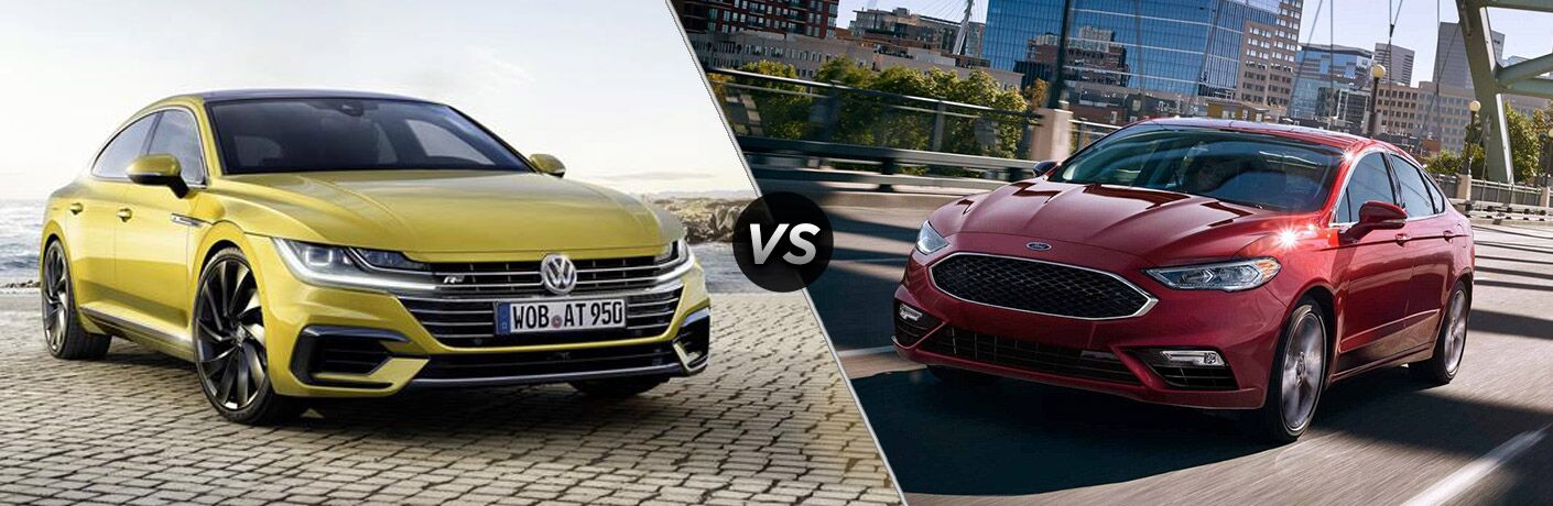Yellow 2019 Volkswagen Arteon next to red 2019 Ford Fusion in comparison image