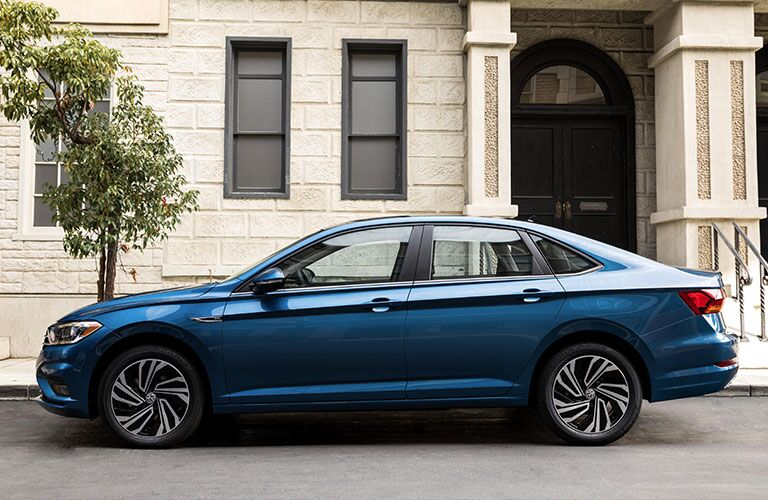 2019 Volkswagen Jetta in front of a stone house