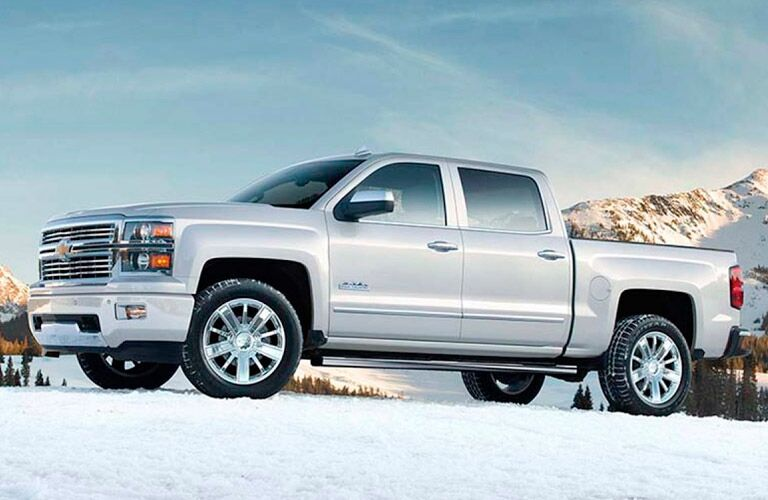 White crew cab Silverado in the snow