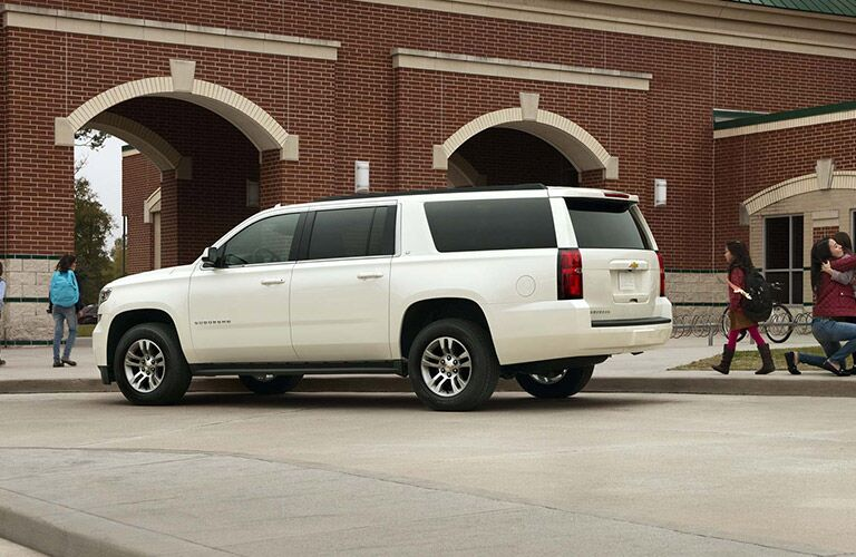 Chevy Suburban parked outside a school