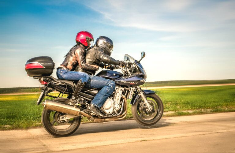 Traveling as a couple can be fun when safely riding a used motorcycle from Joe's Auto Sales