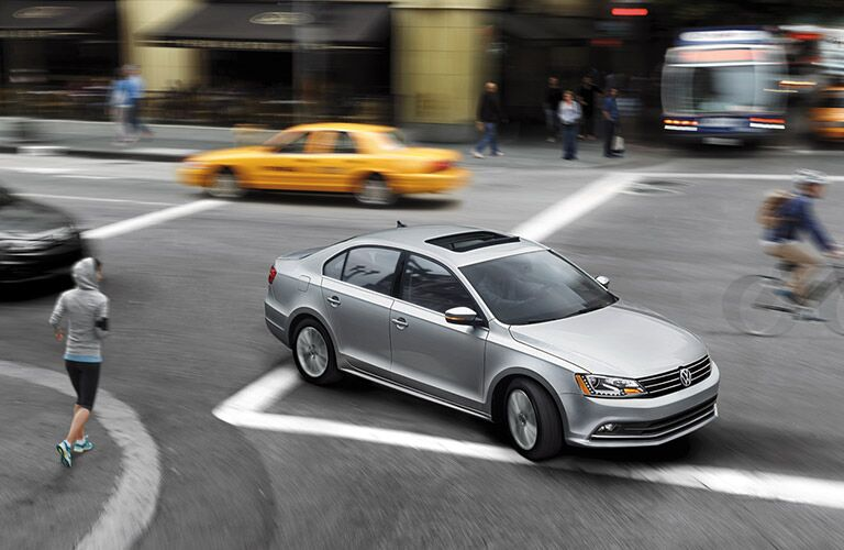 Silver 2016 VW Jetta in the city