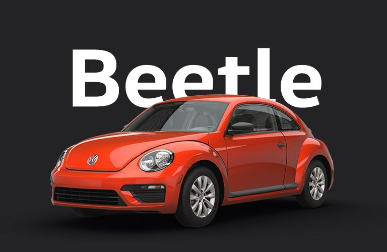 "Orange Volkswagen Beetle sits against a black background and gigantic white text that reads, ""Beetle."""