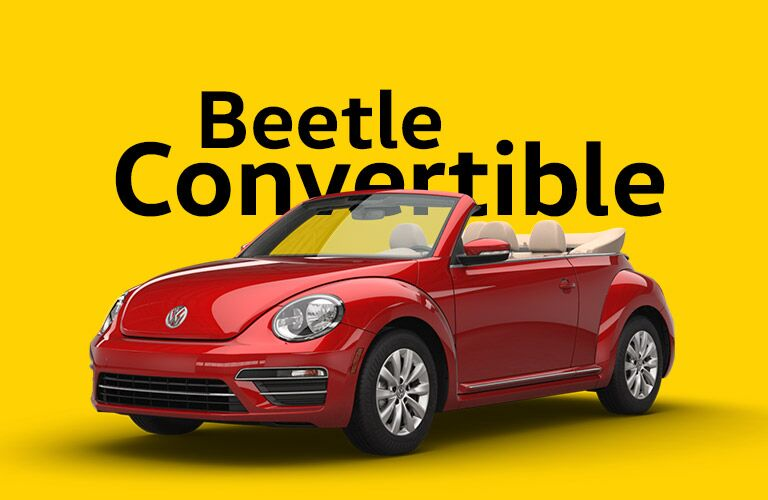 "Red VW Beetle Convertible sits on a yellow background beneath large text that reads, ""Beetle Convertible."""