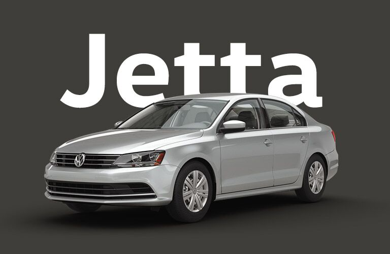 "Silver Volkswagen Jetta sits on a black background under large white text that reads, ""Jetta."""