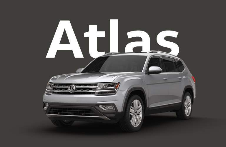 "Silver Volkswagen Atlas sits in front of a black background under large white text that reads, ""Atlas."""
