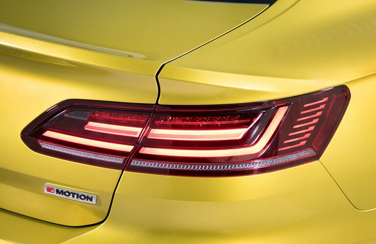 Close-up on an LED taillight of a yellow 2019 Volkswagen Arteon.