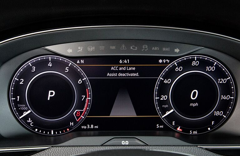 Close-up on the dashboard guages of a 2019 Volkswagen Arteon, with Lane Keep Assist displayed on the center LED screen.