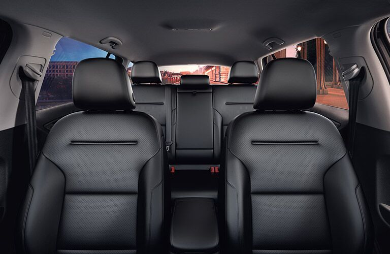 Interior rear facing view from the front of a 2019 Volkswagen Golf Alltrack interior, showcasing the rows of seats all the way back.