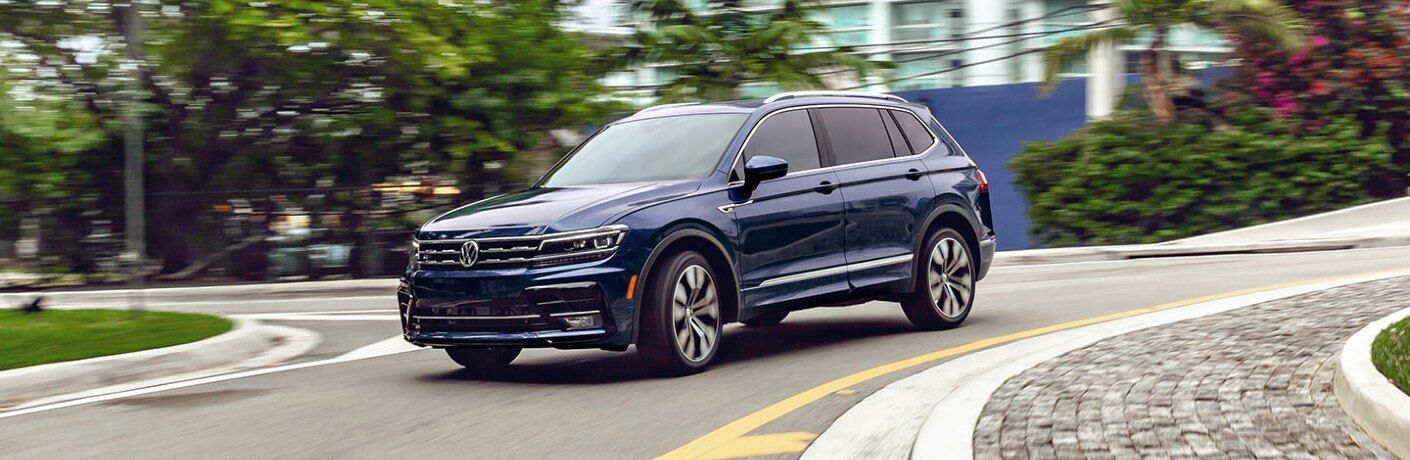 2021 Tiguan driving around a curve