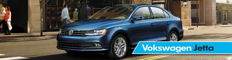 blue 2018 Volkswagen Jetta on the road